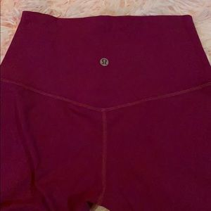 LuluLemon cropped magenta leggings.